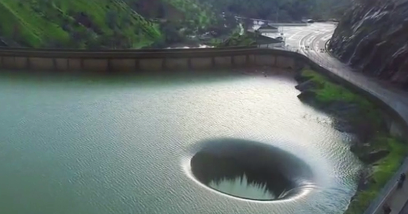 "Amazing Drone Footage Of A ""Hole"" In A Lake"